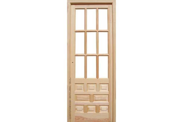 puerta de interior a cuarterones. castellana. maciza de madera
